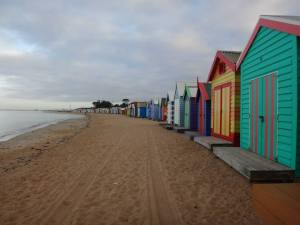 The beach huts all brightly painted, lined up, reminding me of home
