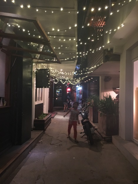 Phnom Penh lane ways lit up, reminiscent of the hipster Melbourne network